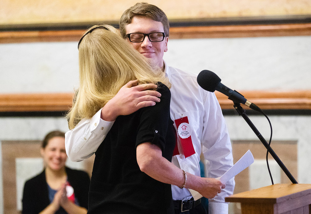 Keegan Bredemeyer hugs his adoptive mother Stacey after she spoke about their story during the Celebrate Life rally in the rotunda of the Capitol Sunday, Jan. 27, 2019. [Ted Schurter/The State Journal-Register]