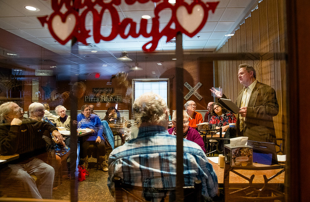 The Rev. Michael Henderson preaches to members of the First Baptist Church inside a partitioned space at Pizza Ranch in Springfield Sunday, Jan. 27, 2019. The church sold its formerly building but was delayed moving into their new facility at 4150 Sandhill Road, on the city's far north side so it conducted worship service at the restaurant. [Ted Schurter/The State Journal-Register]