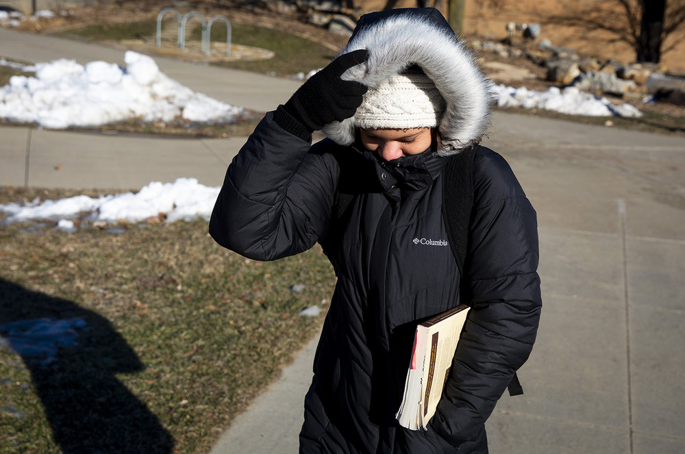 Halle Stuart braces against a frigid wind on a walk across the University of Illinois Springfield campus for a European history class Tuesday, Jan. 29, 2019 in Springfield, Ill. [Rich Saal/The State Journal-Register]