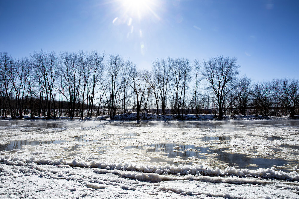 Steam rises from the surface of the Sangamon River where it isn't covered by ice flow Wednesday, Jan. 30, 2019 along Irwin Bridge Road near Athens, Ill. [Rich Saal/The State Journal-Register]
