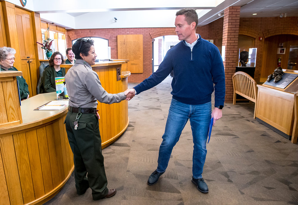 Vanessa Torres, an employee with the National Park Service, is greeted by U.S. Rep. Rodney Davis, R-Taylorville, as he holds a press conference in the theatre of site to discuss with employees the effects of the government shut down on them and the long term effects to the Lincoln Home National Historic Site, Friday, Feb. 1, 2019, in Springfield, Ill. [Justin L. Fowler/The State Journal-Register]