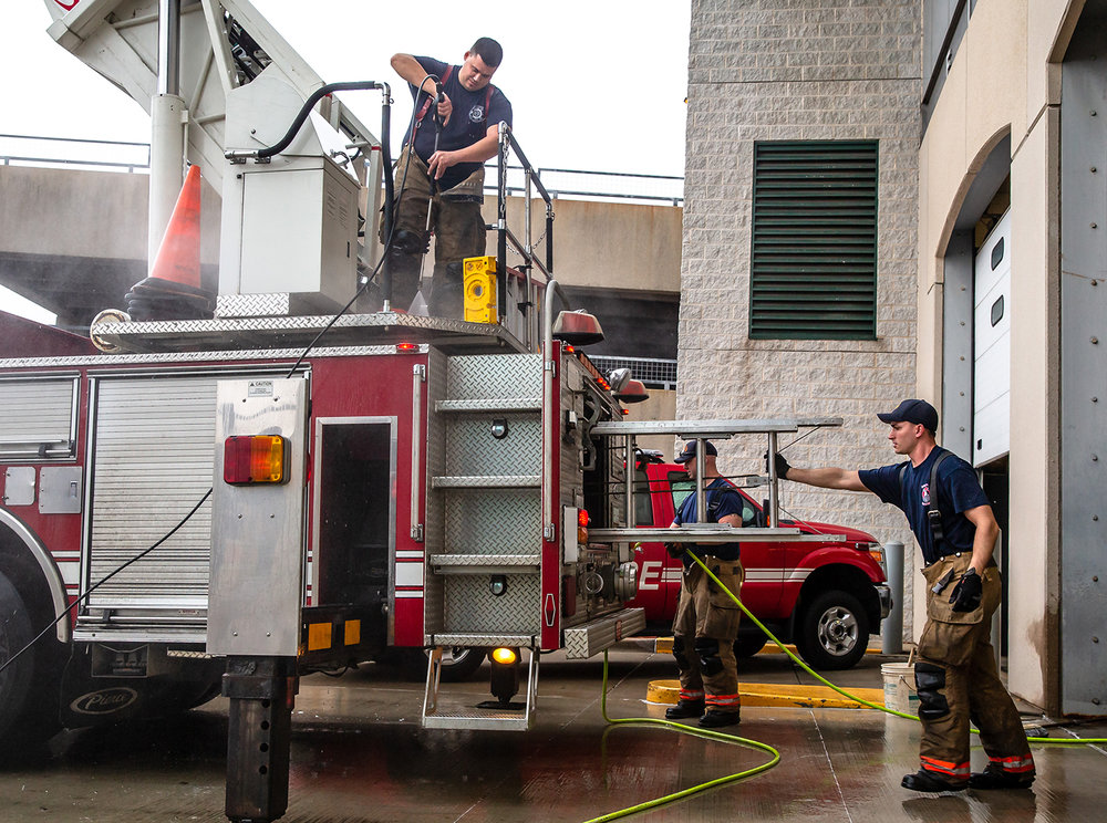 Springfield firefighter Jerrod Marfell, left, driver engineer Butch Flowers, center, and firefighter Mark Maggio give Truck 3 a thorough cleaning while familiarizing themselves with the fire truck on loan from Fire Station No. 12, Monday, Feb. 4, 2019, in Springfield, Ill. The crew normally operates Truck 1 out of Fire Station No. 1, but that fire truck is currently out for maintenance so they will run Truck 3 while it is being serviced and a spare will go into service at Fire Station No. 12. [Justin L. Fowler/The State Journal-Register]