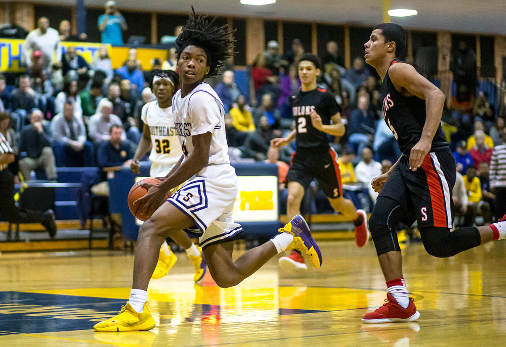 Southeast's Terrion Murdix (4) checks over his shoulder as he drives in for the layup on a fast break against Springfield in the first half at Southeast High School, Tuesday, Feb. 5, 2019, in Springfield, Ill. [Justin L. Fowler/The State Journal-Register]