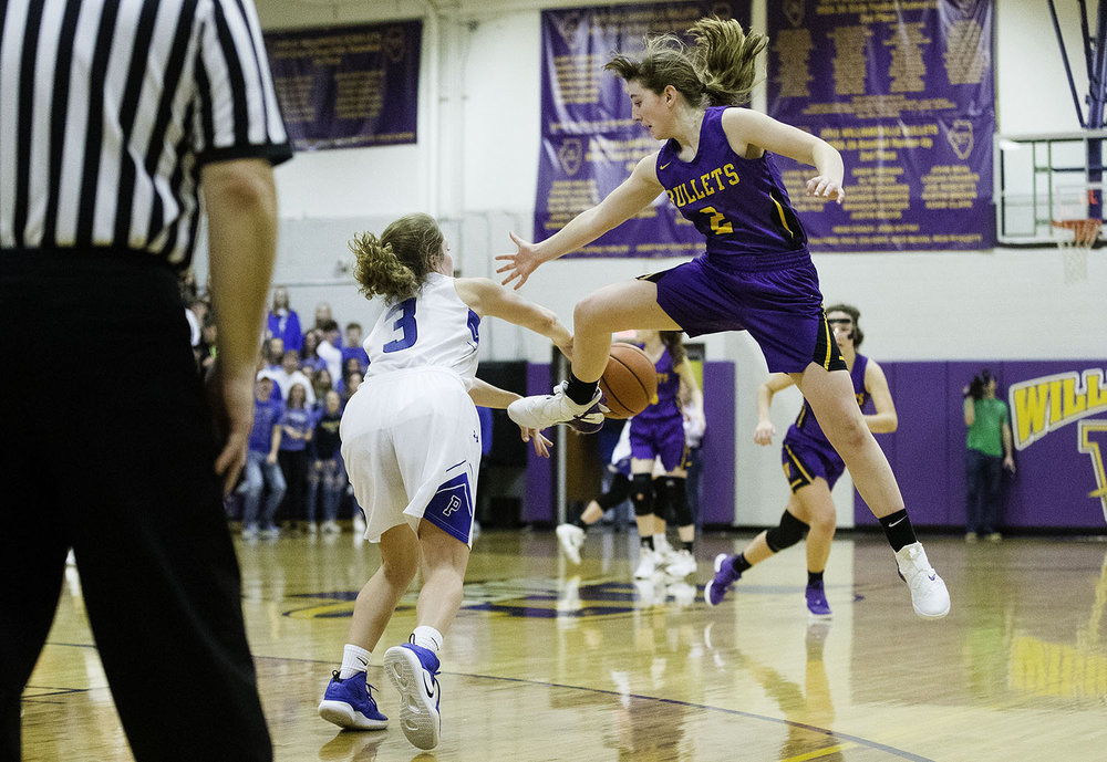 Williamsville's Maddie Roberts pressures PORTA's Kyia Privia as she passes the ball upcourt during the 2A Williamsville Regional at Williamsville High School Thursday, February 7, 2019. [Ted Schurter/The State Journal-Register]