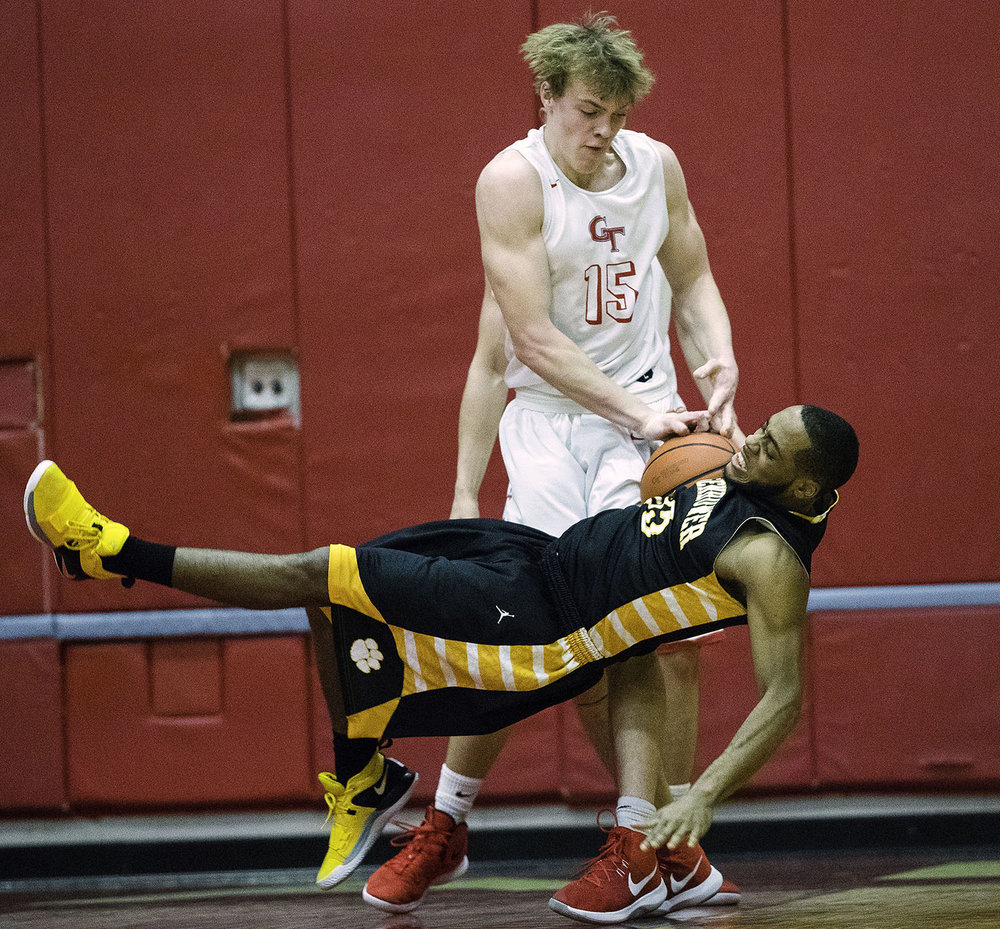 Glenwood's Eli Vogler flings Davionne Fitzpatrick to the ground as they wrestle for a jump ball at Glenwood High School Friday, February 8, 2019. [Ted Schurter/The State Journal-Register]