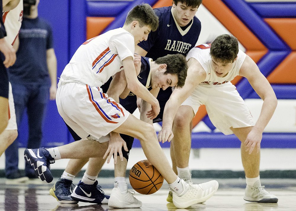 Quincy Notre Dame's Nick Schwartz battles with Pleasant Plains' Justin Guernsey and Joel Niermann for a loose ball during the Riverton Subway Shootout at Riverton High School Saturday, Feb. 9, 2019. [Ted Schurter/The State Journal-Register]