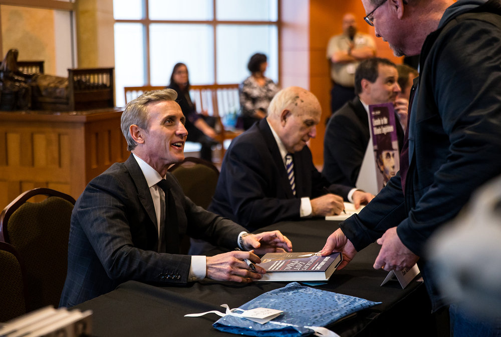 "Dan Abrams, ABC News' chief legal affairs anchor, signs copies of his new book ""Lincoln's Last Trial: The Murder Case That Propelled Him to the Presidency"" during a book signing during the Abraham Lincoln Symposium at the Abraham Lincoln Presidential Library, Tuesday, Feb. 12, 2019, in Springfield, Ill. [Justin L. Fowler/The State Journal-Register]"