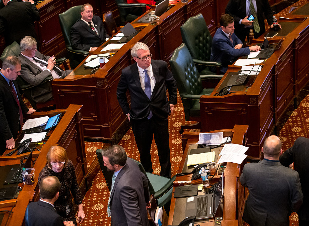 Illinois House Minority Leader Jim Durkin, R-Western Springs, stands on the House floor as debate continues on  Senate Bill 1, a bill to raise the minimum wage to $15 by 2025, at the Illinois State Capitol, Thursday, Feb. 14, 2019, in Springfield, Ill. [Justin L. Fowler/The State Journal-Register]