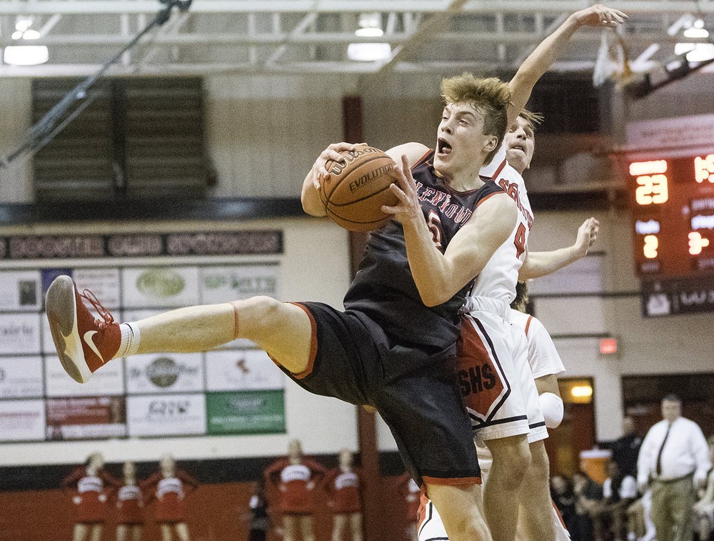 Glenwood's Eli Vogler grabs a rebound in front of Springfield's Brayden Schmohe at Springfield High School Friday, Feb. 15, 2019. [Ted Schurter/The State Journal-Register]
