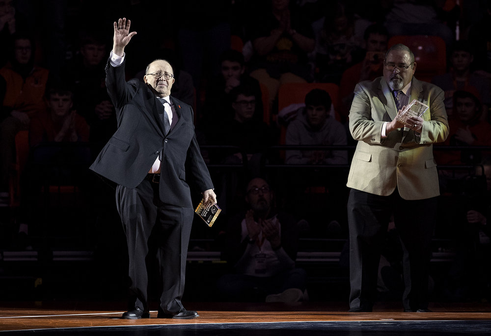 Mt. Olive wrestling coach Ron Ryan waves to the crowd as he is recognized as a Grand Marshall at the IHSA 2019 State Wrestling Championships at the State Farm Center in Champaign Saturday, Feb. 16, 2019. Ryan is retiring after 50 years as a wrestling coach. [Ted Schurter/The State Journal-Register]