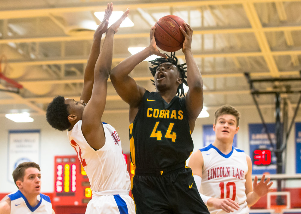 Parkland College's Bruno Williams Jr. (44) goes up for a shot against Lincoln Land Community College's DJ Doolin (12) in the first half at Lincoln Land Community College's Cass Gymnasium, Wednesday, Feb. 20, 2019, in Springfield, Ill. [Justin L. Fowler/The State Journal-Register]