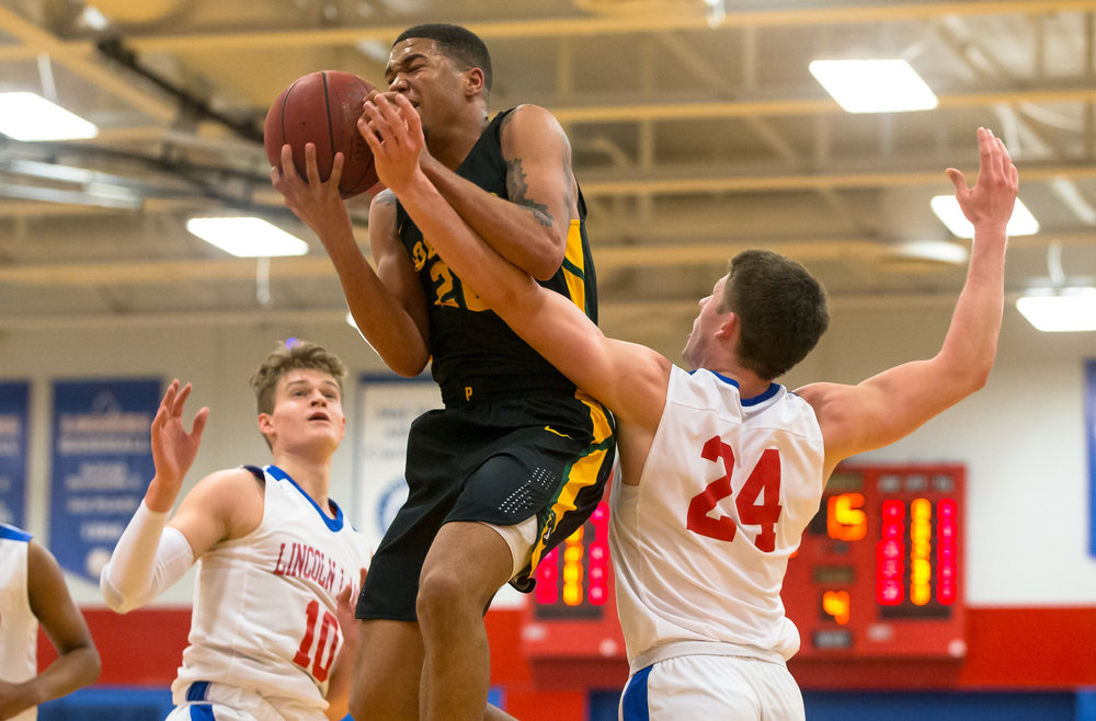 Parkland College's Carter Jeffries (20) draws the foul from Lincoln Land Community College's Nic Hagel (24) as he goes up for a shot in the first half at Lincoln Land Community College's Cass Gymnasium, Wednesday, Feb. 20, 2019, in Springfield, Ill. [Justin L. Fowler/The State Journal-Register]