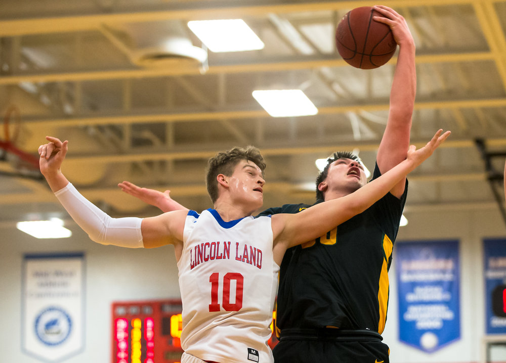 Parkland College's Joey Saracco (50) goes for a rebound against Lincoln Land Community College's Benji Eaker (10) in the first half at Lincoln Land Community College's Cass Gymnasium, Wednesday, Feb. 20, 2019, in Springfield, Ill. [Justin L. Fowler/The State Journal-Register]