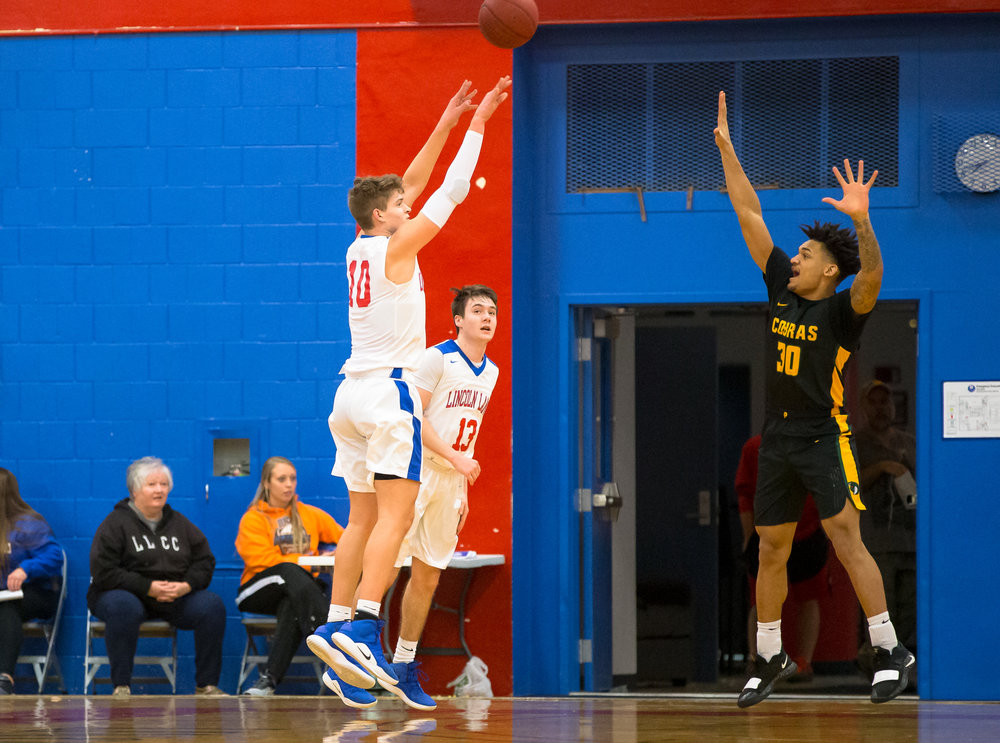 Lincoln Land Community College's Benji Eaker (10) launches a 3-pointer against Parkland College's Ty Walter Jr. (30) in the first half at Lincoln Land Community College's Cass Gymnasium, Wednesday, Feb. 20, 2019, in Springfield, Ill. [Justin L. Fowler/The State Journal-Register]