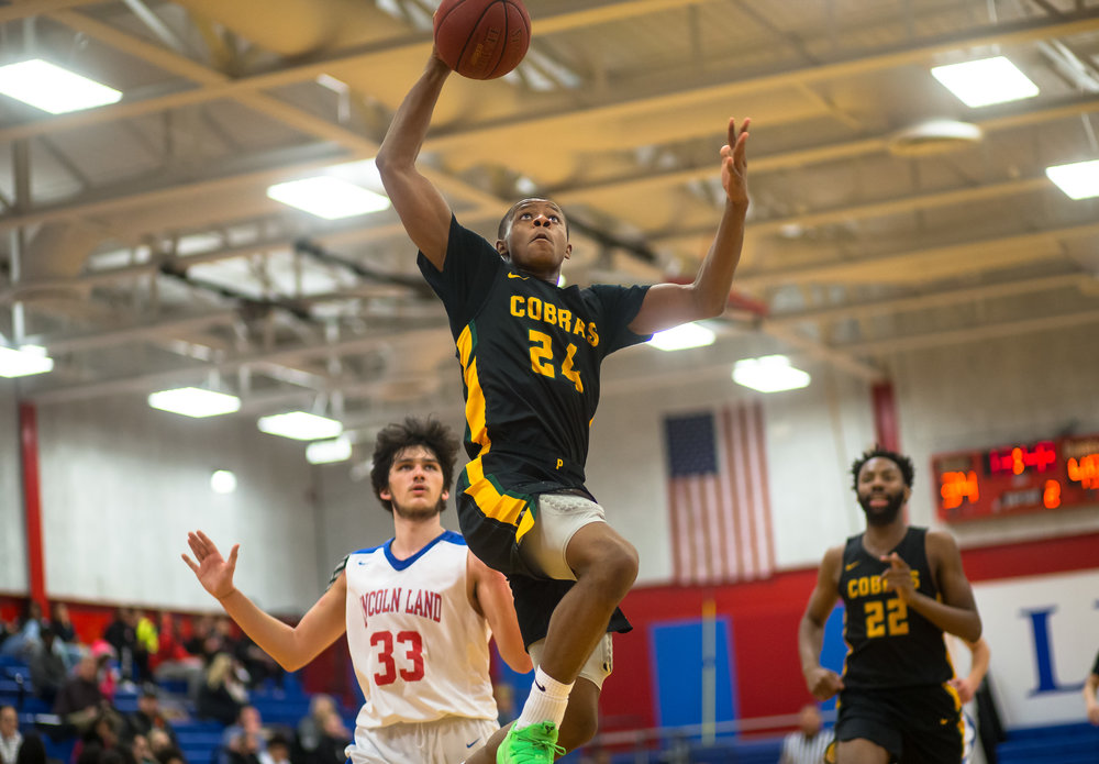 Parkland College's Charles Campbell Jr. (24) goes up for a dunk against Lincoln Land Community College's Jake Pennell (33) in the second half at Lincoln Land Community College's Cass Gymnasium, Wednesday, Feb. 20, 2019, in Springfield, Ill. [Justin L. Fowler/The State Journal-Register]