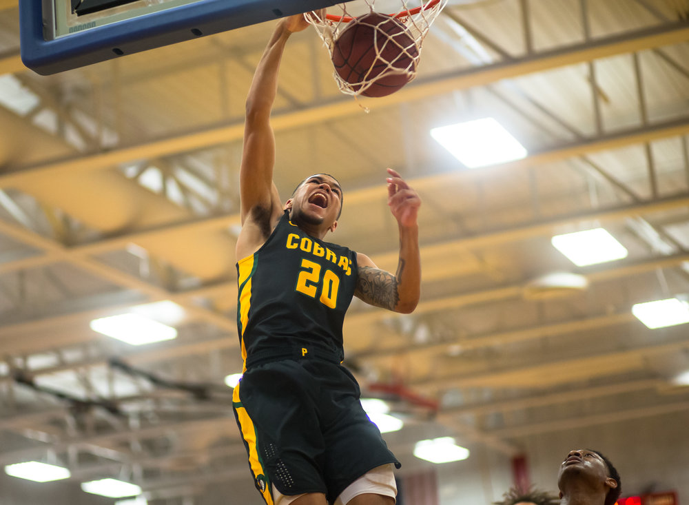 Parkland College's Carter Jeffries (20) throws down a dunk against Lincoln Land Community College in the second half at Lincoln Land Community College's Cass Gymnasium, Wednesday, Feb. 20, 2019, in Springfield, Ill. [Justin L. Fowler/The State Journal-Register]