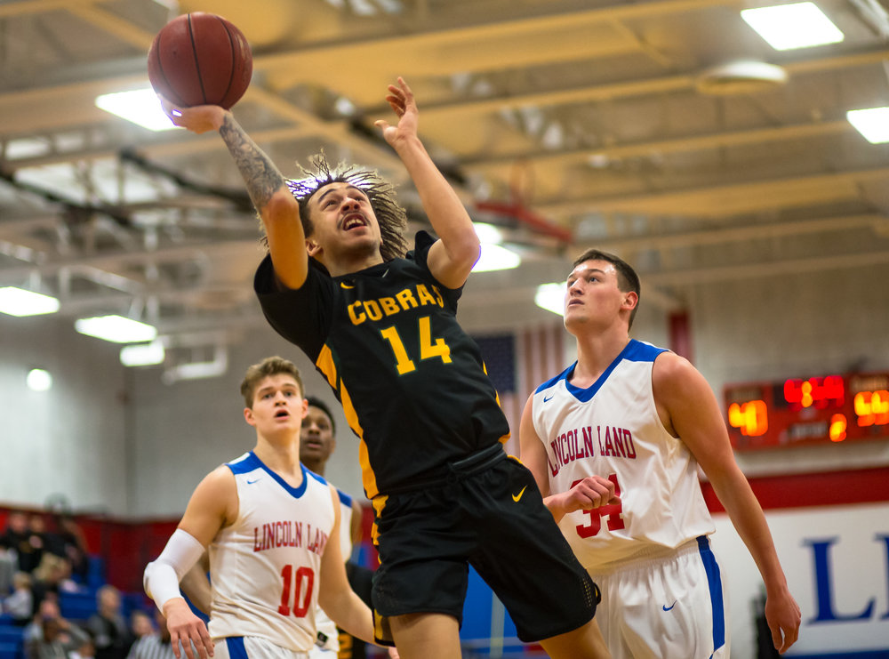 Parkland College's Jordan Coleman (14) goes up for a shot against Lincoln Land Community College's Mitch Hardiek (34) in the second half at Lincoln Land Community College's Cass Gymnasium, Wednesday, Feb. 20, 2019, in Springfield, Ill. [Justin L. Fowler/The State Journal-Register]