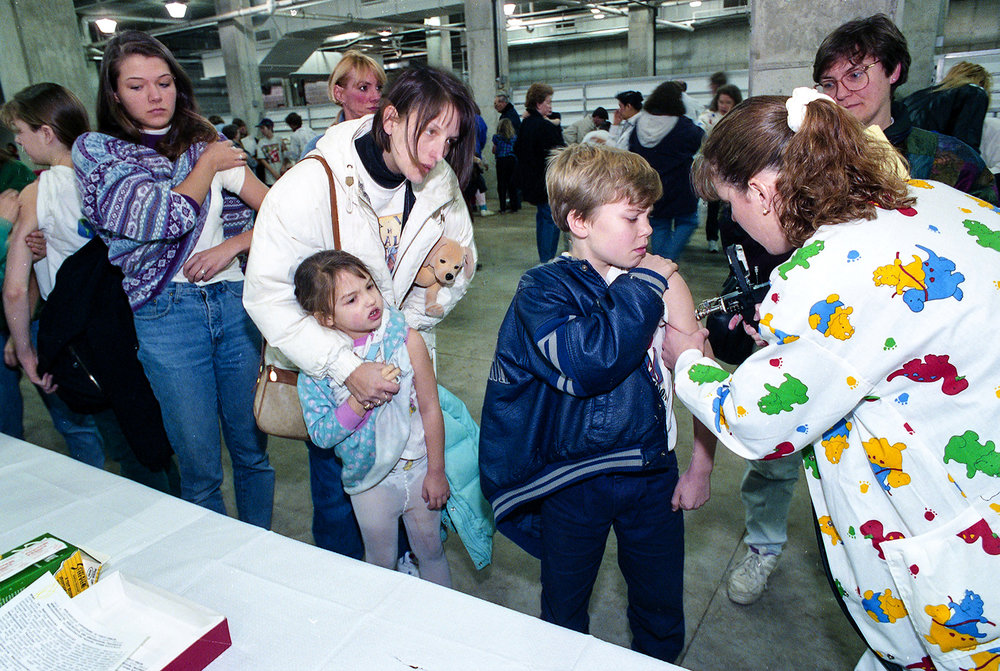 Mass immunization for bacterialmeningitis held Feb. 5, 1994 in the Livestock Center on the Illinois State Fairgrounds. File/David Spencer/The State Journal-RegisterPublished as Picturing the Past Feb. 24, 2019When a kindergartner at Lee School was hospitalized with bacterialmeningitisJanuary 25, 1994, it was the ninth case in 12 months in the Springfield area, an unusually high number. Two children died from the infection. By comparison, there were no cases reported in 1991 or 1992. And just four days later, when a month-old baby was diagnosed with a similar strain of the bacteria, the Springfield health department said it didn't believe a mass immunization of children was necessary. But on Feb. 2, Brian Letourneau, director of the Springfield Public Health Department, changed course and announced that a voluntary immunization program for children age 2-18 would be held on both days that weekend in the Livestock Center on the state fairgrounds. On the first day of the vaccinations, an estimated 8,000 shots were administered. People waited in a half-mile-long line that snaked from the Main Gate, through Happy Hollow and up to the Livestock Center in temperatures that hovered in the mid-30s. Letourneau said there were few surprises during the first day of the operation, but admitted that he hadn't thought about having portable toilets available for those in line. They were ordered for the following day. Two more clinics were held within the next week and by the end, more than 21,000 children from Springfield and Sangamon County had been given the shots. Letourneau said they reached 99.5 percent of the target population, and called it an incredible result for a program planned in four days. No cases were ever reported among those who were immunized. File/David Spencer/The State Journal-Register