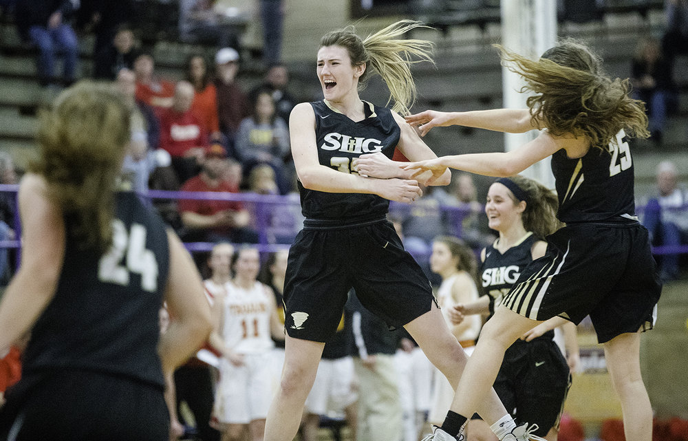 Sacred-Heart Griffin's Victoria Zeigler leaps into the air as she celebrates with her teammates after beating Charleston during the Taylorville Class 3A Girls Sectional at Taylorville High School Monday, Feb. 18, 2019. [Ted Schurter/The State Journal-Register]