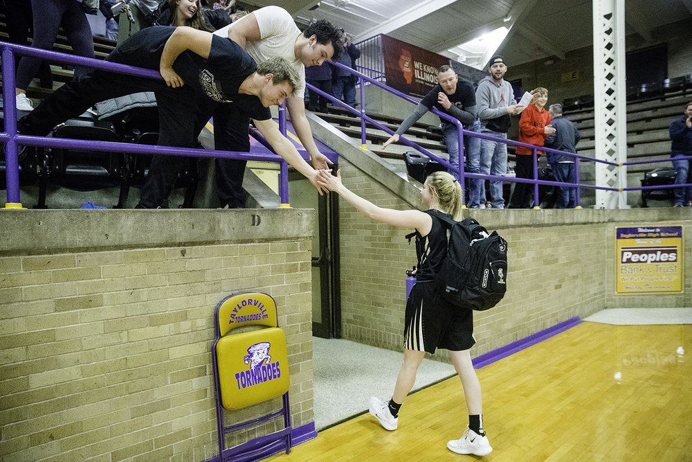 Cyclone fans congratulate Sacred-Heart Griffin's Payton Vorreyrer as she exits the gym after defeating Charleston during the Taylorville Class 3A Girls Sectional at Taylorville High School Monday, Feb. 18, 2019. [Ted Schurter/The State Journal-Register]