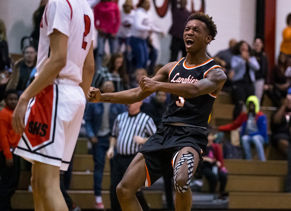 Lanphier's Karl Wright (3) reacts after the Lions defeat Springfield 66-59 in overtime at Springfield High School, Tuesday, Feb. 19, 2019, in Springfield, Ill. [Justin L. Fowler/The State Journal-Register]