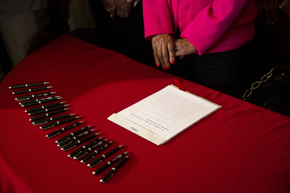 The law to raise the minimum wage in Illinois, SB1, waits for Gov. J.B. Pritzker's signature during a ceremony Tuesday, Feb. 19, 2019 at the Executive Mansion in Springfield, Ill. [Rich Saal/The State Journal-Register]