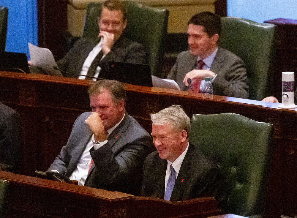 Senate Minority Bill Brady, R-Bloomington, left, and House Minority Leader Jim Durkin, R-Western Springs, smile when Gov. J.B. Pritzker commented on the dancing at the Inaugural Ball during the governor's Budget Address to a joint session of the General Assembly Wednesday, Feb. 20, 2019 at the Capitol in Springfield, Ill. [Rich Saal/The State Journal-Register]