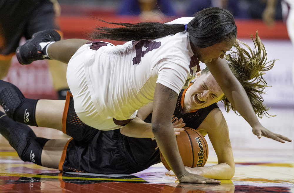 Hillsboro's Sammi Matoush and Marshall's Brandi Hudson tumble to the ground after colliding going after a loose ball during the Class 2A Girls Basketball State Semifinals at Redbird Arena in Normal Friday, Feb. 22, 2019. [Ted Schurter/The State Journal-Register]