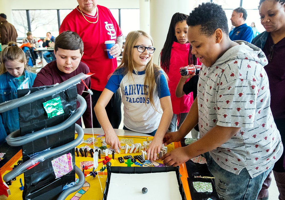 Alicia Adkins, left, and Malachi Lewis laugh as they set their Rube Goldberg machine for a practice run at the 13th annual Springfield Area Fifth Grade Rube Goldberg Competition at Lincoln Land Community College Saturday, Feb. 23, 2019. [Ted Schurter/The State Journal-Register]