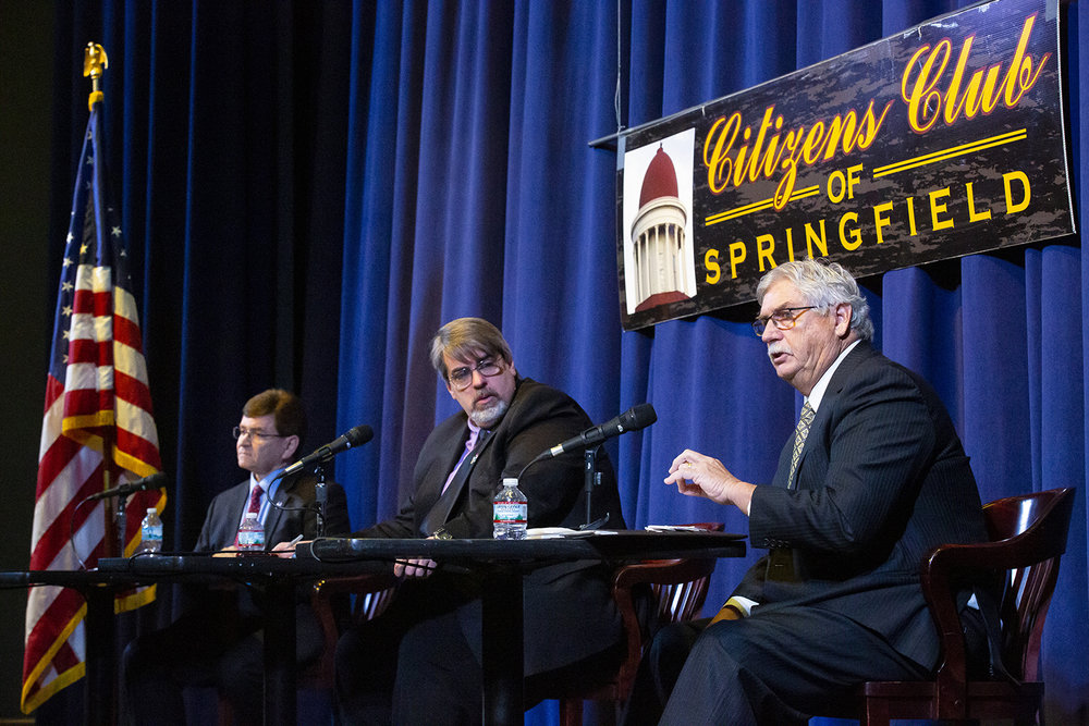 Mayor Jim Langfelder, left, and candidate Frank Edwards face off in a mayoral forum hosted by the Citizens Club of Springfield Friday, Feb. 22, 2019 at the Hoogland Center for the Arts in Springfield, Ill. The forum was moderated by Jim Leach, center, news director of WMAY News Talk 970. [Rich Saal/The State Journal-Register]