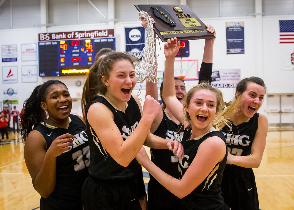 Sacred Heart-Griffin's Jalen Butler (33), left, Sofie Lowis (24), Payton Vorreyer (13) and Maggie Gilmore (22) join their teammates as they celebrate defeating Effingham 56-40 in the Class 3A Springfield Supersectional at UIS' The Recreation and Athletic Center, Monday, Feb. 25, 2019, in Springfield, Ill. [Justin L. Fowler/The State Journal-Register]