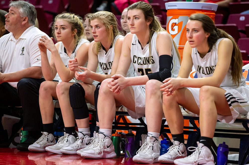 Sacred Heart-Griffin's Payton Vorreyer (13), left, Addison Scarlette (14), Victoria Zeigler (35) and Maggie Gilmore (22) watch as the final seconds tick off the clock as the Cyclones are defeated by Glen Ellyn Glenbard South 32-27 in the IHSA Class 3A State Tournament semifinals at Redbird Arena, Friday, March 1, 2019, in Normal, Ill. [Justin L. Fowler/The State Journal-Register]