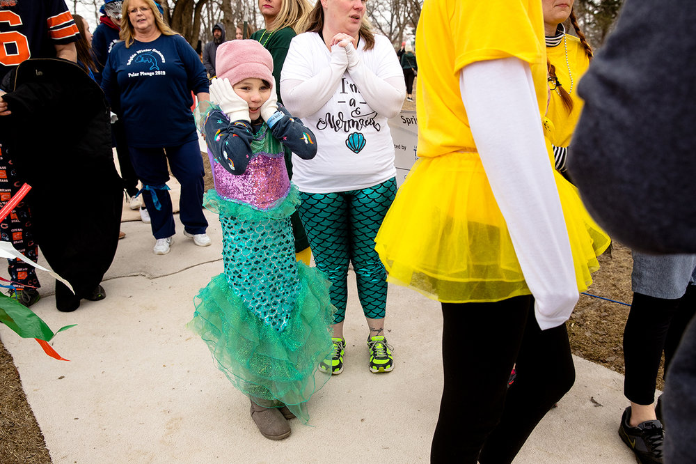 A young plunger dressed as a mermaid prepares herself for the cold water during the 2019 Polar Plunge benefiting the Special Olympics Illinois on Lake Springfield at the Knights of Columbus Lake Club Saturday, March 2, 2019. [Ted Schurter/The State Journal-Register]