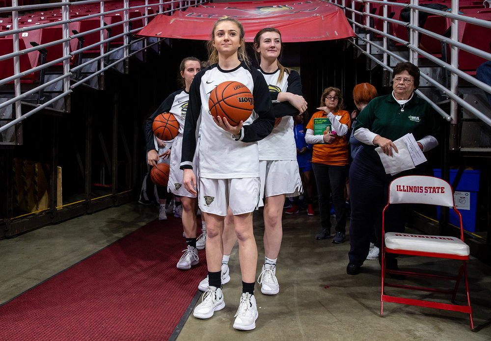 Sacred Heart-Griffin's Payton Vorreyer (13) prepares to lead the Cyclones out on the court to take on Glen Ellyn Glenbard South in the IHSA Class 3A State Tournament semifinals at Redbird Arena, Friday, March 1, 2019, in Normal, Ill. [Justin L. Fowler/The State Journal-Register]