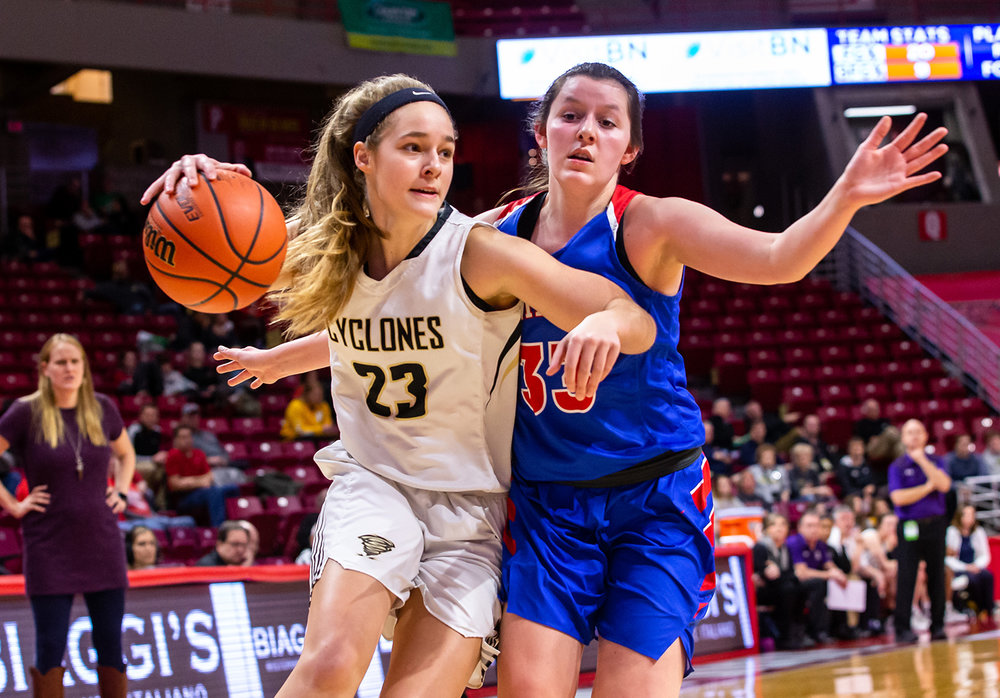 Sacred Heart-Griffin's Emily Brenneisen (23) dribbles around Glen Ellyn Glenbard South's Gianna Coluzzi (33) as she drives towards the basket in the second quarter during the IHSA Class 3A State Tournament semifinals at Redbird Arena, Friday, March 1, 2019, in Normal, Ill. [Justin L. Fowler/The State Journal-Register]