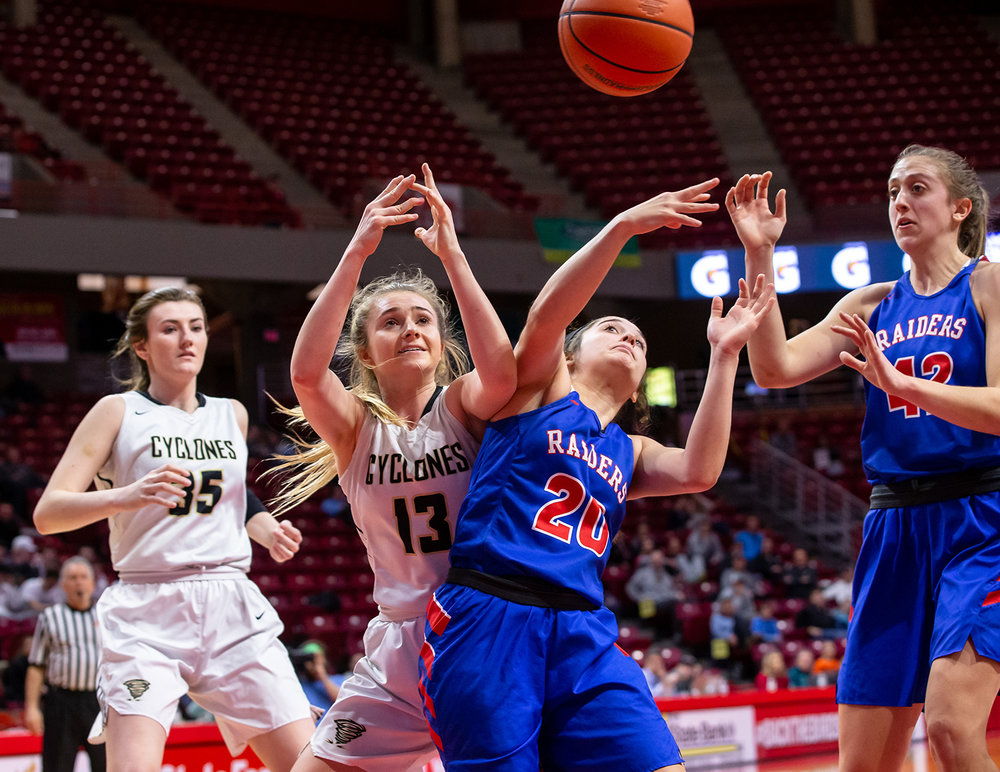 Sacred Heart-Griffin's Payton Vorreyer (13) and Glen Ellyn Glenbard South's Cat Karr (20) get tangled up going for a loose ball in the third quarter during the IHSA Class 3A State Tournament semifinals at Redbird Arena, Friday, March 1, 2019, in Normal, Ill. [Justin L. Fowler/The State Journal-Register]