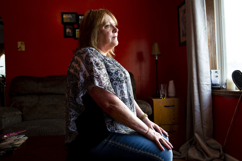 Debbie Squires and her family are hoping for a break in the murder case of her mother, Donna Bricker, 80, who was found dead in her home in early January. Squires was photographed in her home Monday, March 4, 2019  in Springfield, Ill. [Rich Saal/The State Journal-Register]