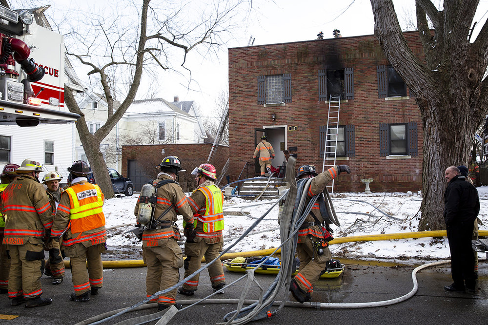 Springfield firefighters extinguished a fire in an apartment building in the 1100 block of West Edwards Street that sent two people to the hospital with non life-threatening injuries Monday, March 4, 2019 in Springfield, Ill. [Rich Saal/The State Journal-Register]