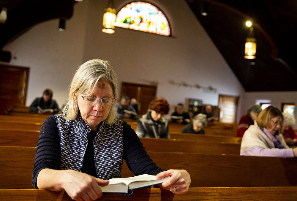 Anne Cornelius follows the closing prayers during an Ash Wednesday service at Christ Episcopal Church Wednesday, March 6, 2019 in Springfield, Ill. For faithful Christians, the holy day of prayer, fasting and repentance marks the beginning of Lent, a period leading up to Easter Sunday. [Rich Saal/The State Journal-Register]