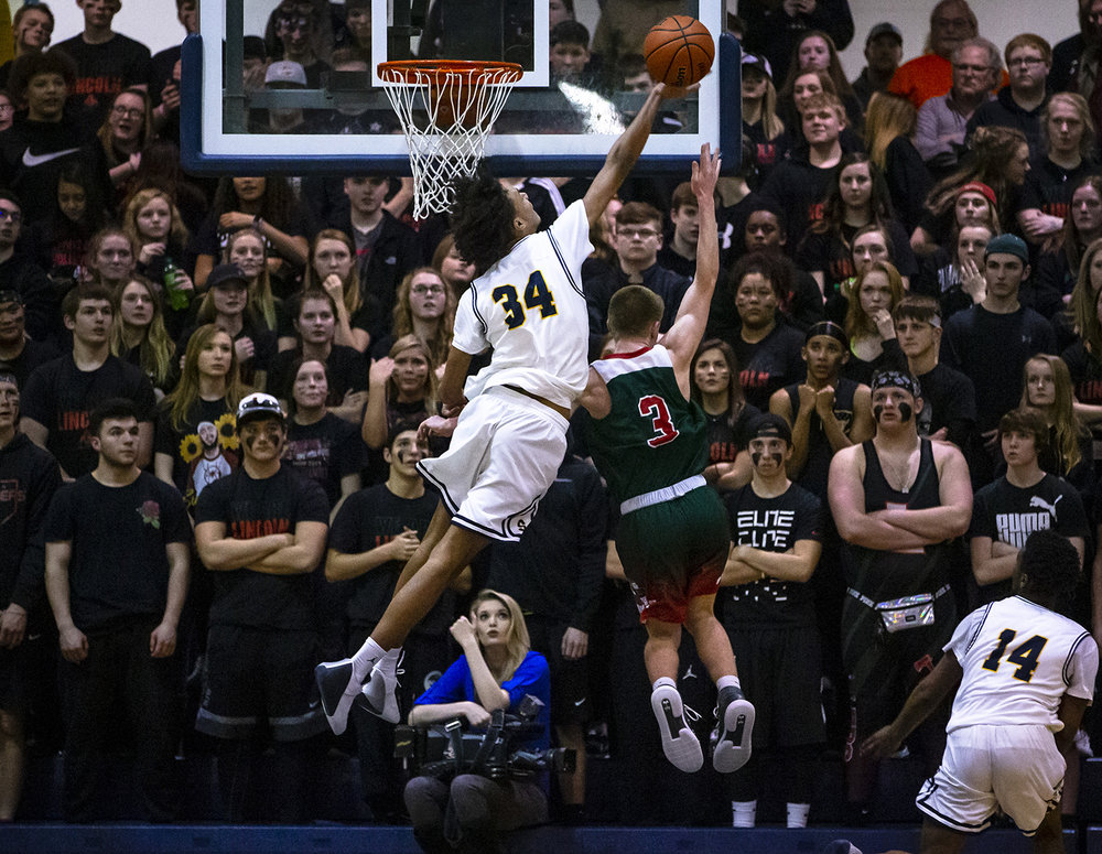 Southeast's Michael Tyler (34) blocks a shot from Lincoln's Dylan Singleton (3) in the second half during the Boys Class 3A Springfield Sectional championship at Herb Scheffler Gymnasium, Friday, March 8, 2019, in Springfield, Ill. [Justin L. Fowler/The State Journal-Register]