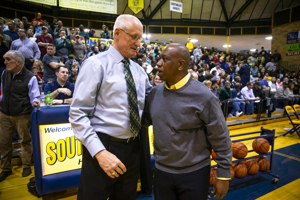 Lincoln boys basketball head coach Neil Alexander and Southeast boys basketball head coach Lawrence Thomas share a hug prior the Railsplitters taking on the Spartans in the Boys Class 3A Springfield Sectional championship at Herb Scheffler Gymnasium, Friday, March 8, 2019, in Springfield, Ill. [Justin L. Fowler/The State Journal-Register]