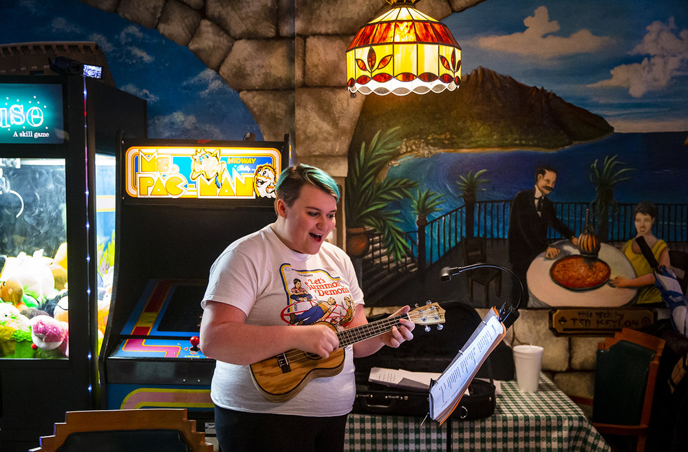"""Hanalyn Girard performs a solo of """"I'm Yours"""" on the ukulele with the Springfield Uketopians during their monthly jam at Joe Gallina's Pizza, Saturday, March 9, 2019, in Springfield, Ill. The Springfield Uketopians have members from all over the state that travel to sing and play the ukulele during their monthly jam on the second Saturday of each month which is open to the and the public to join in. [Justin L. Fowler/The State Journal-Register]"""