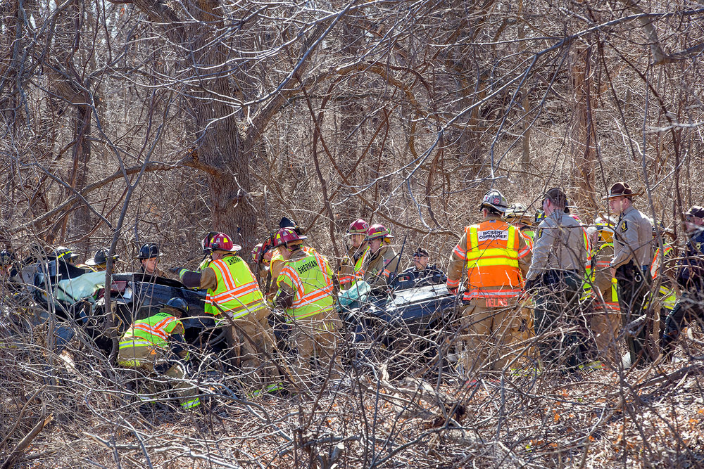 Rescue personnel extricate an occupant from a mangled vehicle at the scene of a single car accident on Interstate 55 south of Sherman Monday, March 11, 2019. [Ted Schurter/The State Journal-Register]