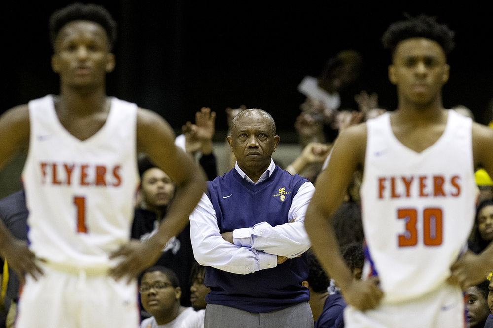 Southeast head coach Lawrence Thomas watches as the Spartans shoot a technical foul during the Class 3A Springfield Supersectional at the Bank of Springfield Center Tuesday, March 12, 2019. [Ted Schurter/The State Journal-Register]