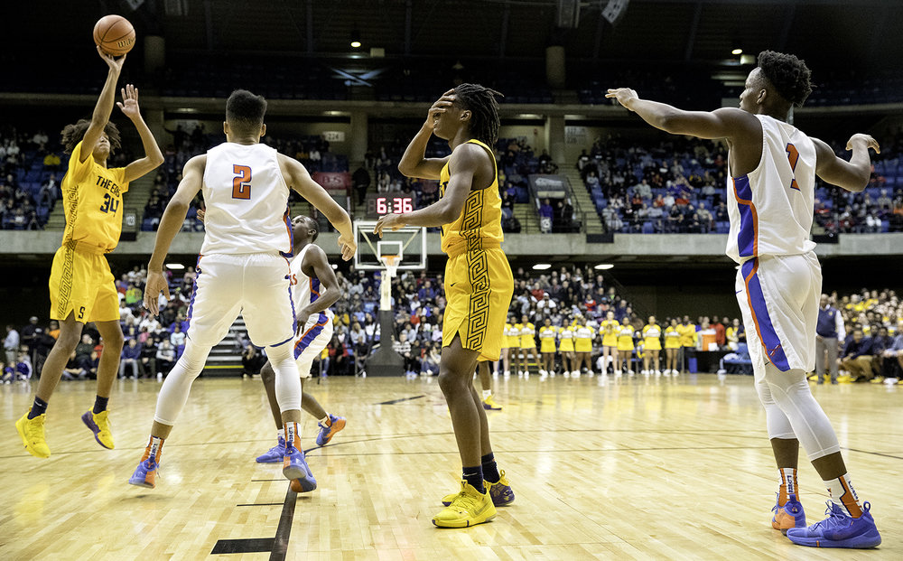 Southeast's Terrion Murdix holds his face after getting hit in the first half during the Class 3A Springfield Supersectional at the Bank of Springfield Center Tuesday, March 12, 2019. [Ted Schurter/The State Journal-Register]