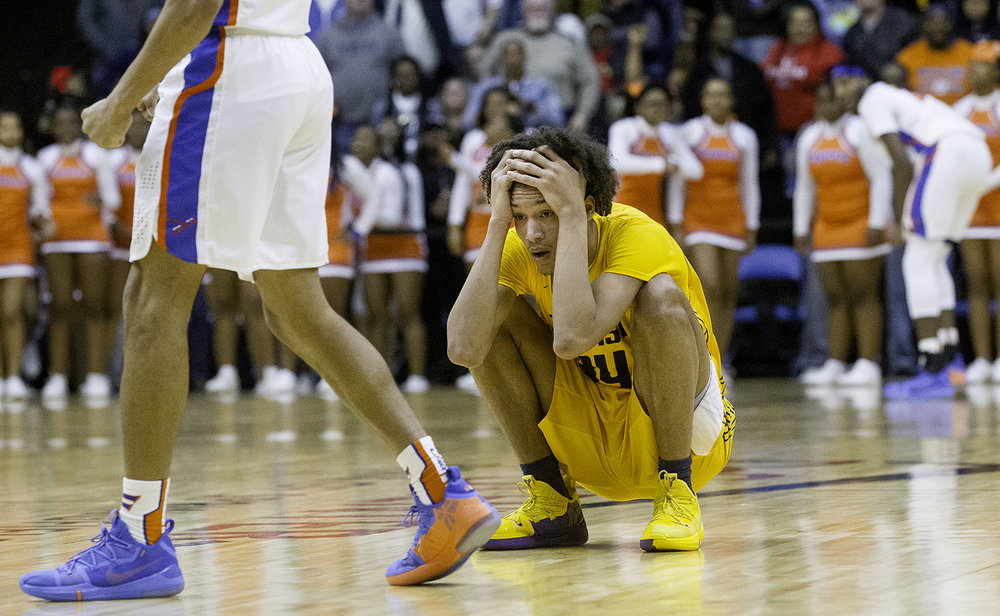 Southeast's Michael Tyler reacts after the Spartans turned the ball over in the final seconds against East St. Louis during the Class 3A Springfield Supersectional at the Bank of Springfield Center Tuesday, March 12, 2019. [Ted Schurter/The State Journal-Register]