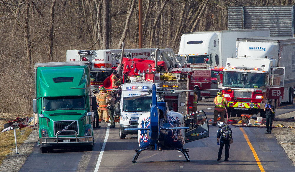 A medic approaches the scene of a two vehicle accident on Interstate 55 after arriving in an air ambulance Thursday, March 14, 2019. Springfield firefighters worked for more than an hour to extricate an occupant from the cab of one of the semi trucks. [Ted Schurter/The State Journal-Register]