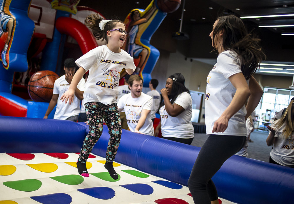 "Kaydence Bosaw, left, spends time leaping through the air with University of Illinois Springfield junior Grace DeCarlo, right, during the UIS Dance Marathon fundraising campaign by the students at the University of Illinois Springfield to benefit the Children's Miracle Network at HSHS St. John's Children's Hospital at the UIS Student Union Ballroom, Saturday, March 23, 2019, in Springfield, Ill. Bowsaw was born prematurely weighing only 1lb. and 15oz. and underwent multiple surgeries spending four months in the NICU at St. John's Children's Hospital and serves as one of the ""Miracles"" for the Children's Miracle Network.  [Justin L. Fowler/The State Journal-Register]"