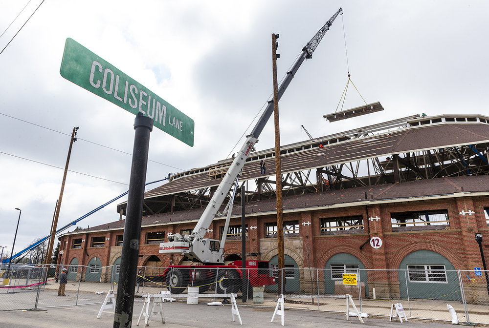 Construction crews remove the roof of the Coliseum a section at a time as work on the purlins and support structure continue on the $10.2 million renovation to the building at the Illinois State Fairgrounds, Monday, March 25, 2019, in Springfield, Ill. The renovations to the Coliseum, which was built in 1901, are expected to be completed in time for for the 2019 Illinois State Fair with crews working two 10-hour shifts when weather and schedules allow it to be done. [Justin L. Fowler/The State Journal-Register]