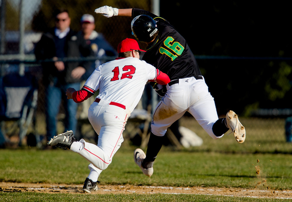 Glenwood's Jake Jurgens tags out U-High's Jacob Mote at first base at Chatham Community Park's Bob Erickson Field Monday, March 26, 2019. [Ted Schurter/The State Journal-Register]